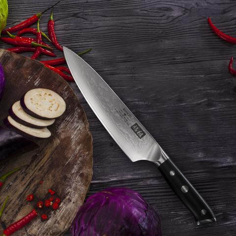 Photo du modèle de couteau Shan Zu en acier de Damas.
